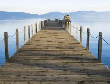 wooden dock with lake tahoe background