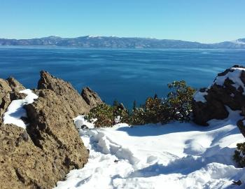 Eagle Rock with snow overlooking tahoe