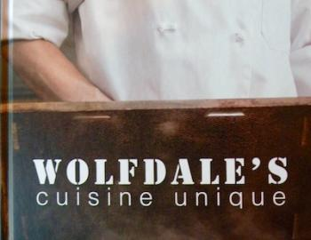 Wolfdales name on wood with chef in background