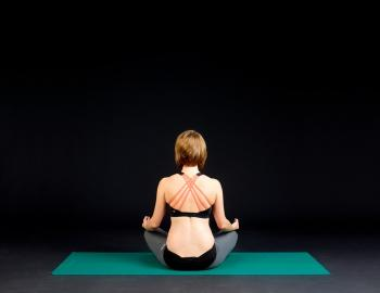 back of woman in a yoga pose