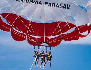 people parasailing in the air