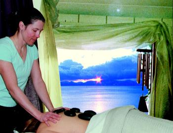woman giving massage overlooking a lake view