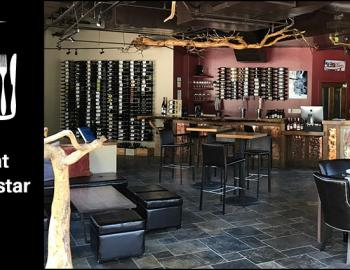 interior of wine bar with tables and chairs