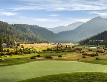 golf course with mountains surrounding