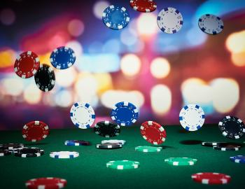gambling chips of many colors falling from the air