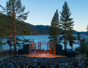 actors stage with waters of tahoe in background