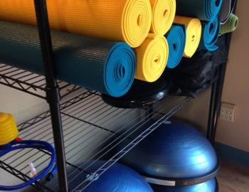yoga mats on a shelf