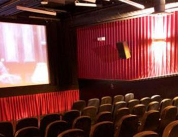seats and movie screen in theater