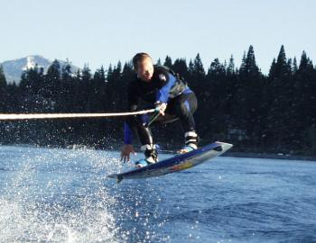 wakeboarder jumping a wake