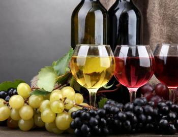 grapes and a glass of red wine and glass of white wine