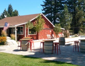 front view of winery with benches and tables outside