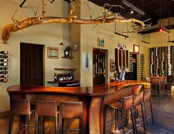 interior of wine bar with wine on walls