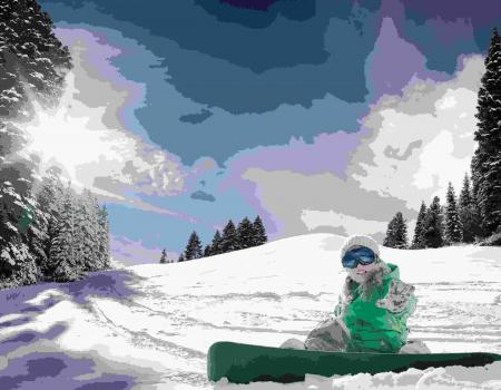 snowboarder sitting on mountain