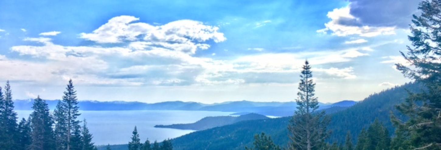 view of blue waters of tahoe with white clouds overhead
