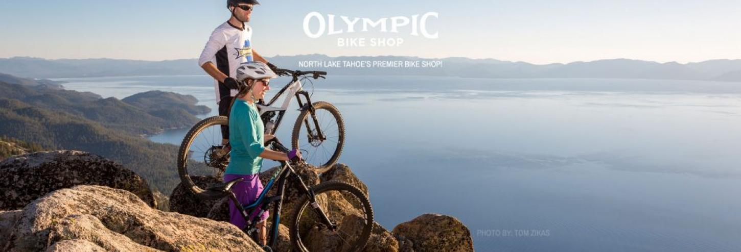 man on a mountain bike overlooking the water