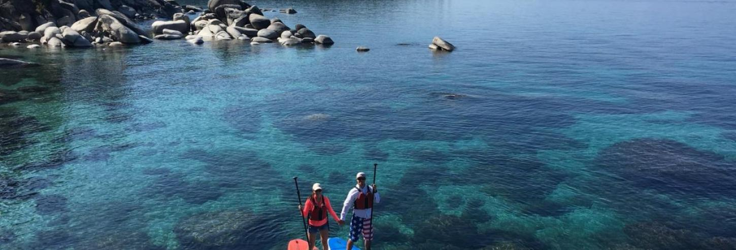 Paddle boards on the shore of lake tahoe