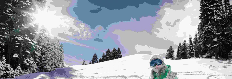 snowboarder sitting on mountain