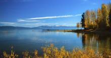 calm lake with fall colors on trees and bushes